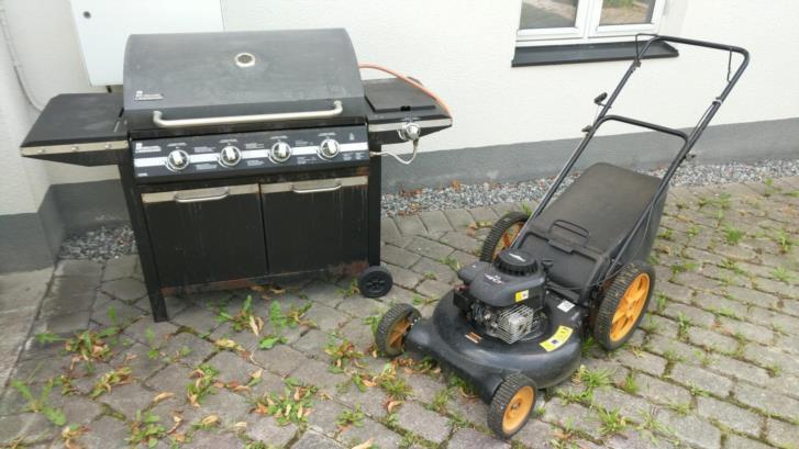 Gasolgrill och bensindriven gräsklippare